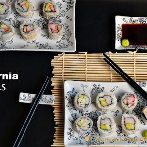 California Rolls on rectangular plates with chopsticks and a small dish of soy sauce