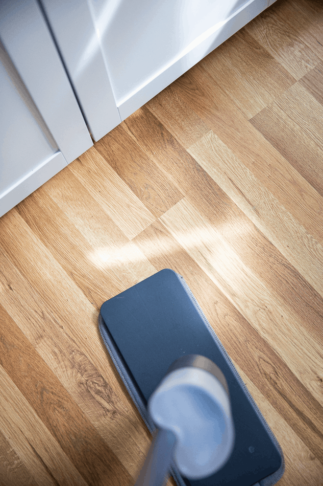 image of wooden floor and mop with homemade cleaner