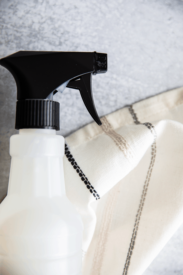 spray bottle filled with homemade disinfectant spray with vinegar