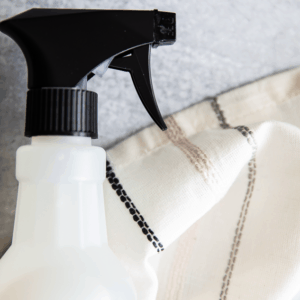 image of homemade cleaner with essential oil on granite surface