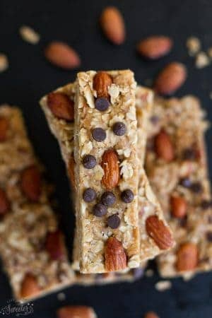 5 Ingredient Granola Bars with almond butter surrounded by almonds.