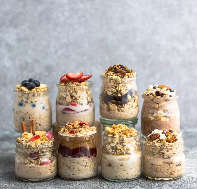 Eight Lined-Up Mason Jars Filled with Flavored Overnight Oats
