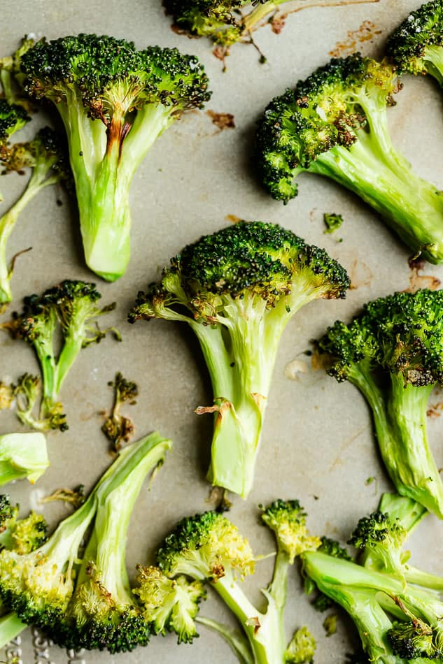 Top view of roasted broccoli on baking sheet.