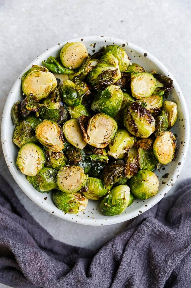 Top view of air fried Brussels sprouts in a white bowl
