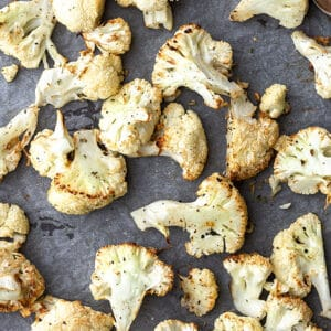 Top view of air fried cauliflower on a grey background