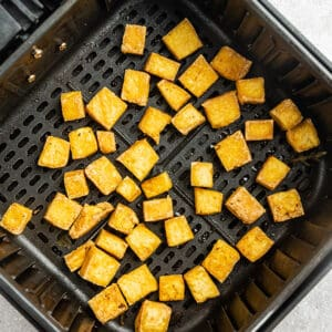 Crispy air fried tofu in the air fryer basked