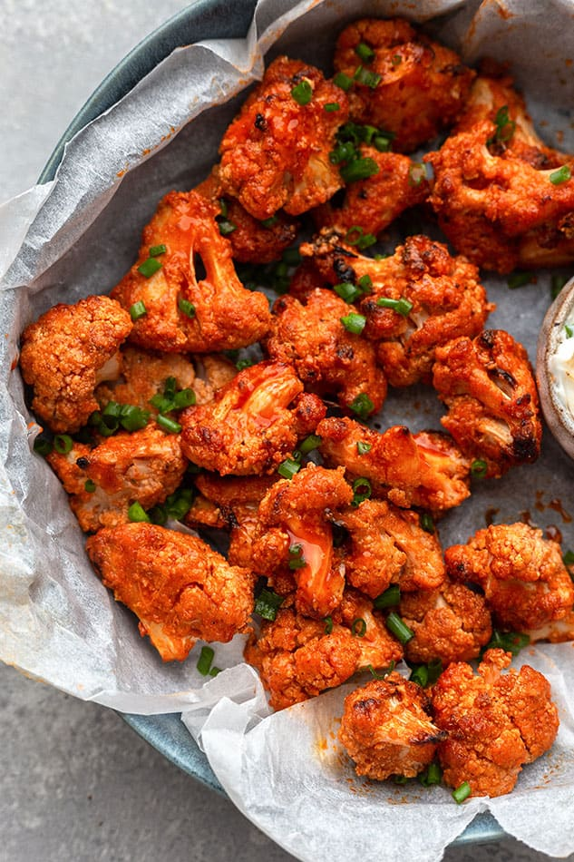 Overhead view of BBQ Cauliflower Wings in a paper-lined serving dish