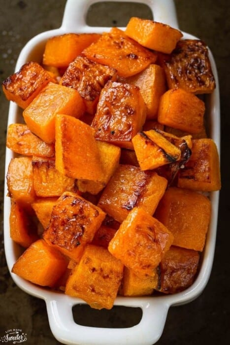 Top view of air fryer butternut squash in a white casserole dish