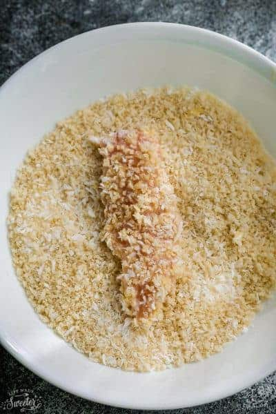 Top view of air fryer chicken in the keto breading in a white bowl
