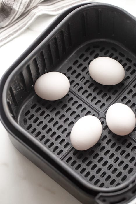 Four Large, White Eggs in the Basket of an Air Fryer