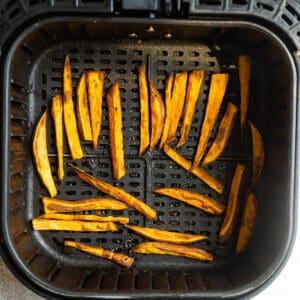 Crispy sweet potato fries in the air fryer basket