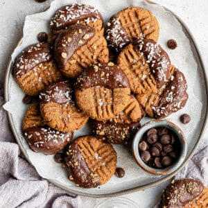 A plate of chocolate almond flour cookies in a plate with chocolate
