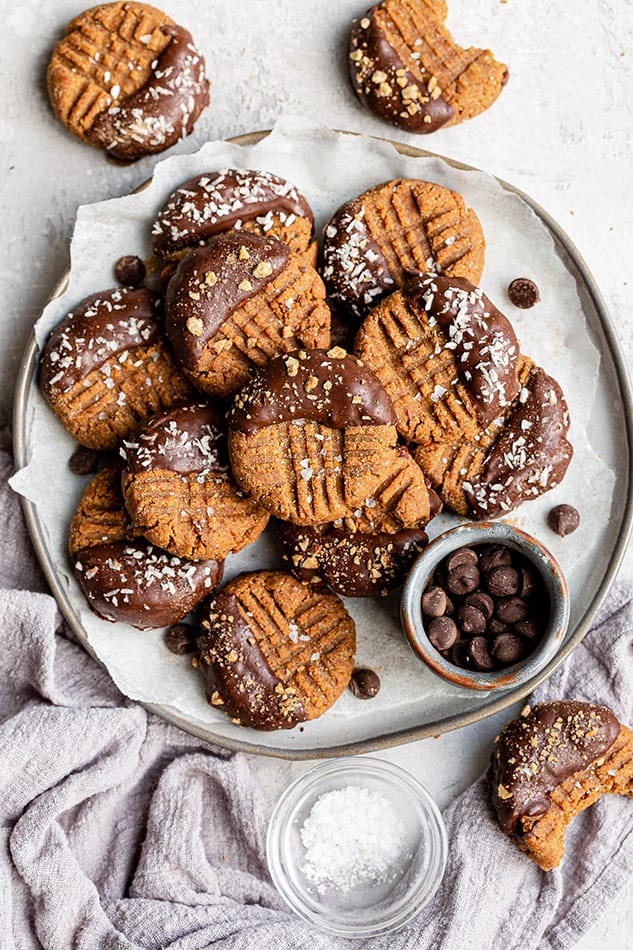 Overhead view of Chocolate Dipped Almond Flour cookies on a plate
