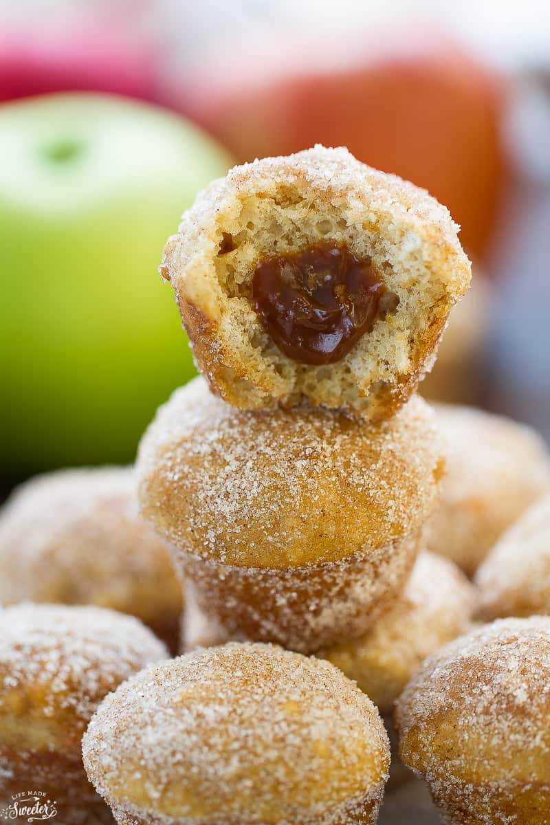 Side view of a stack of apple cider donut muffins on a plate