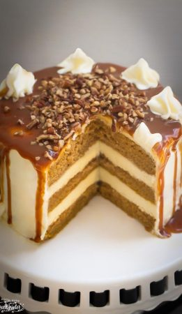 Missing slice of delicious Apple Cider Spice Cake with Salted Caramel Drizzle on a cake plate.