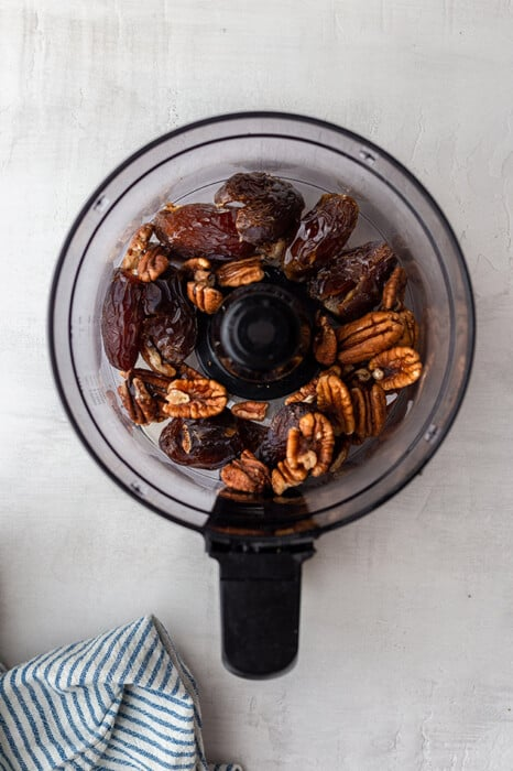 Top view of Medjool dates and pecans in a food processor