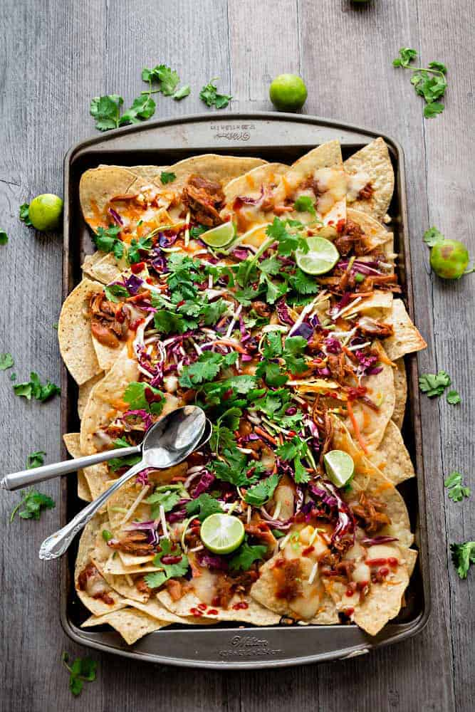 Asian Chicken Nachos - a simple and flavorful appetizer perfect for parties, game day or any meal you want. Best of all, easy to make ahead in the slow cooker or the Instant Pot.