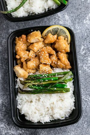 Asian Honey Lemon Chicken Meal Prep Lunch Bowls - coated in a citrus sweet & tangy sauce that is even better than your local takeout restaurant! Best of all, it's full of authentic flavors and super easy to make with just 15 minutes of prep time. Skip that takeout menu! This is so much better and healthier! Weekly meal prep for the week and leftovers are great for lunch bowls for work or school.