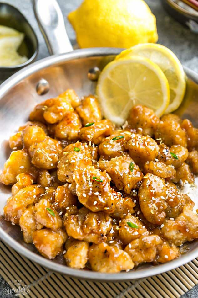 Asian Honey Lemon Chicken - coated in a refreshingly sweet. savory & tangy sauce that is even better than your local Chinese takeout restaurant! Best of all, it's full of authentic flavors and super easy to make with about 10 minutes of prep time. Instructions for pan-frying and baking in the oven.Skip that takeout menu! This is so much better and healthier! Weekly meal prep or leftovers are great for lunch bowls for work or school.