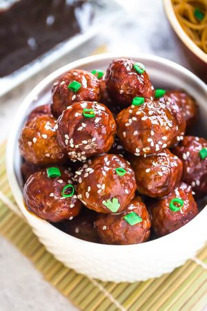 Asian Glazed Meatballs - moist and tender chicken meatballs are the perfect appetizers for game day and any Super Bowl parties. Best of all, they are so full of flavor - baked and coated in a sweet and sticky glaze.