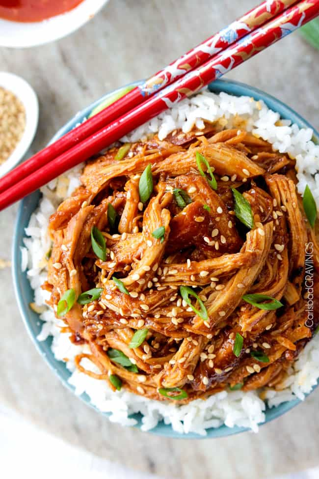 Overhead view of Slow Cooker Asian Sweet Chili Chicken over rice in a bowl