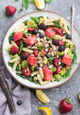 Berry Avocado Spinach Pasta Salad - the perfect summer salad for easy lunches, potlucks, barbecues & parties. Best of all, this recipe comes together quickly with healthy greens, in-season fruit, chopped nuts and crumbled cheese.