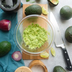 Homemade Guacamole - this quick and simple recipe is the perfect easy party dip with tortilla chips or along with tacos or by the spoonful. Best of all, only 6 ingredients to make for your next Mexican-inspired meal.