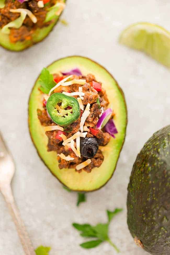 Taco Stuffed Avocado Cups – a fun appetizer based on the classic Mexican favorite and perfect for parties. Best of all, this recipe is gluten free, keto and low-carb friendly.