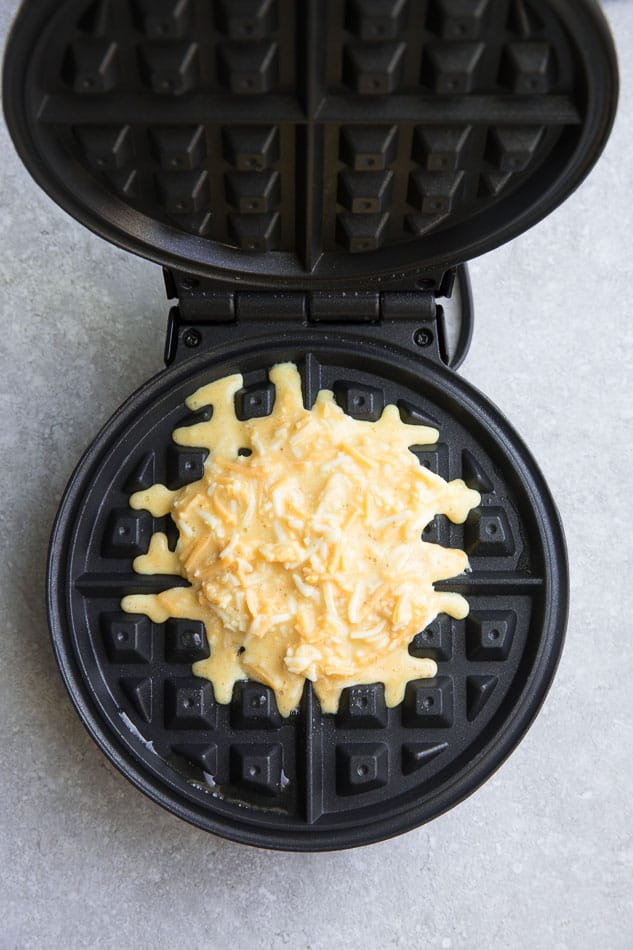Top view of chaffle batter in a belgian waffle iron