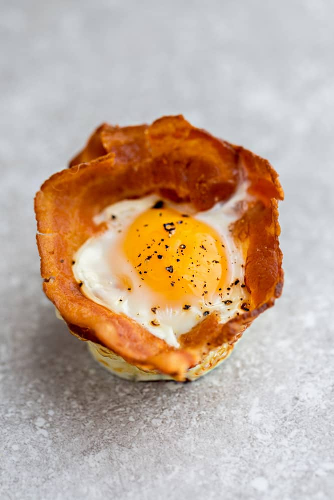 Top view of 1 Bacon Baked Egg Cup on a grey background