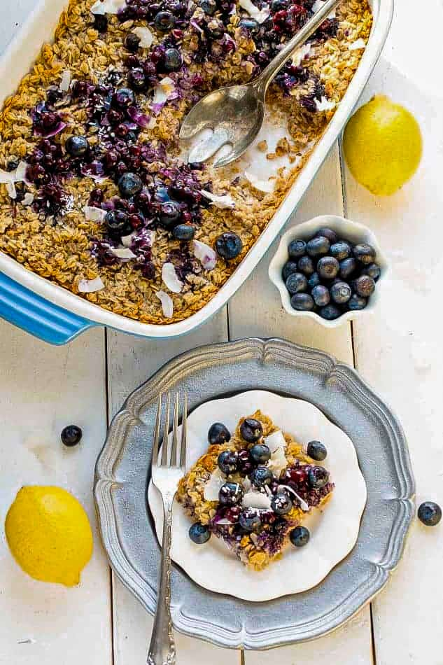 A Plate of Blueberry Baked Oatmeal Next to the Rest of the Casserole on a White Table