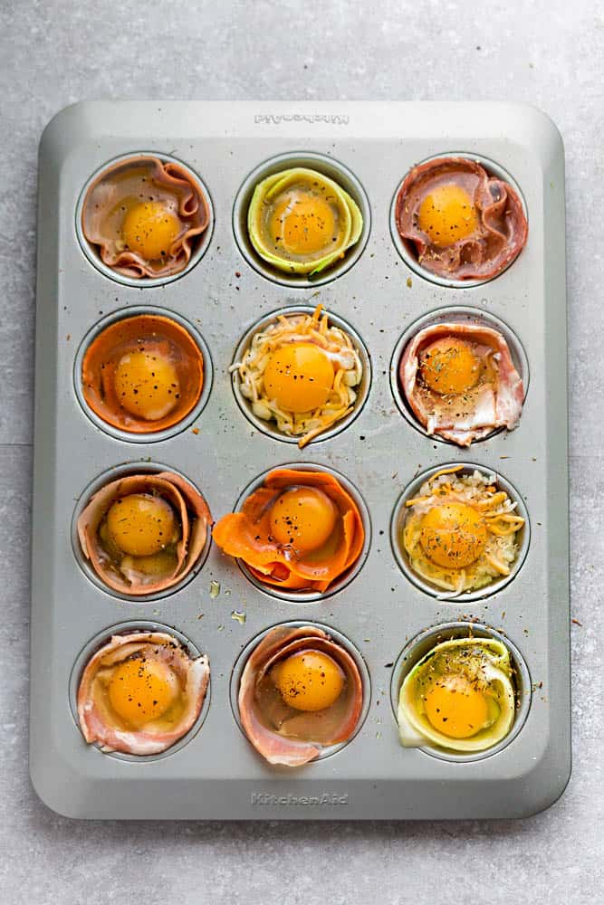 Baked Egg Cups - 9 Ways are the perfect low carb and protein packed breakfast. Best of all, they are super simple to customize and come together in less than 30 minutes!