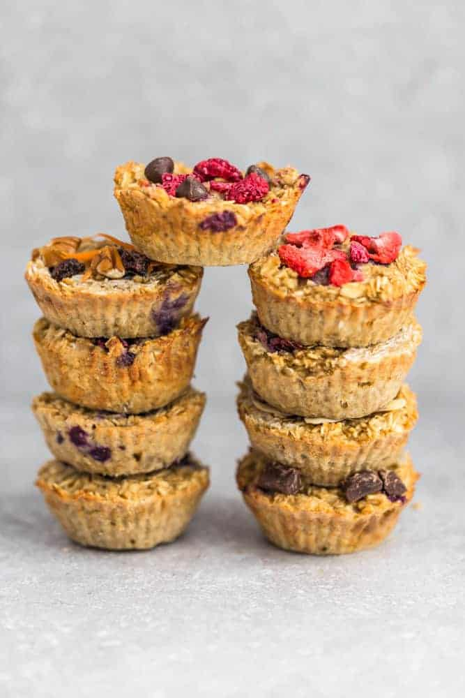 These baked oatmeal cups make the perfect easy and healthy make-ahead breakfast to enjoy throughout the week. Best of all, they're simple to customize and include recipes for 10 different ways to make them plus useful tips. Refined sugar free, gluten free and vegan. LEMON ALMOND POPPY SEED, STRAWBERRY, RASPBERRY CHOCOLATE CHIPS, PINEAPPLE COCONUT, HONEY WALNUT, ALMOND BUTTER & BANANA, PUMPKIN CRANBERRY & CARROT CAKE, CHOCOLATE CHUNK & APPLE CINNAMON