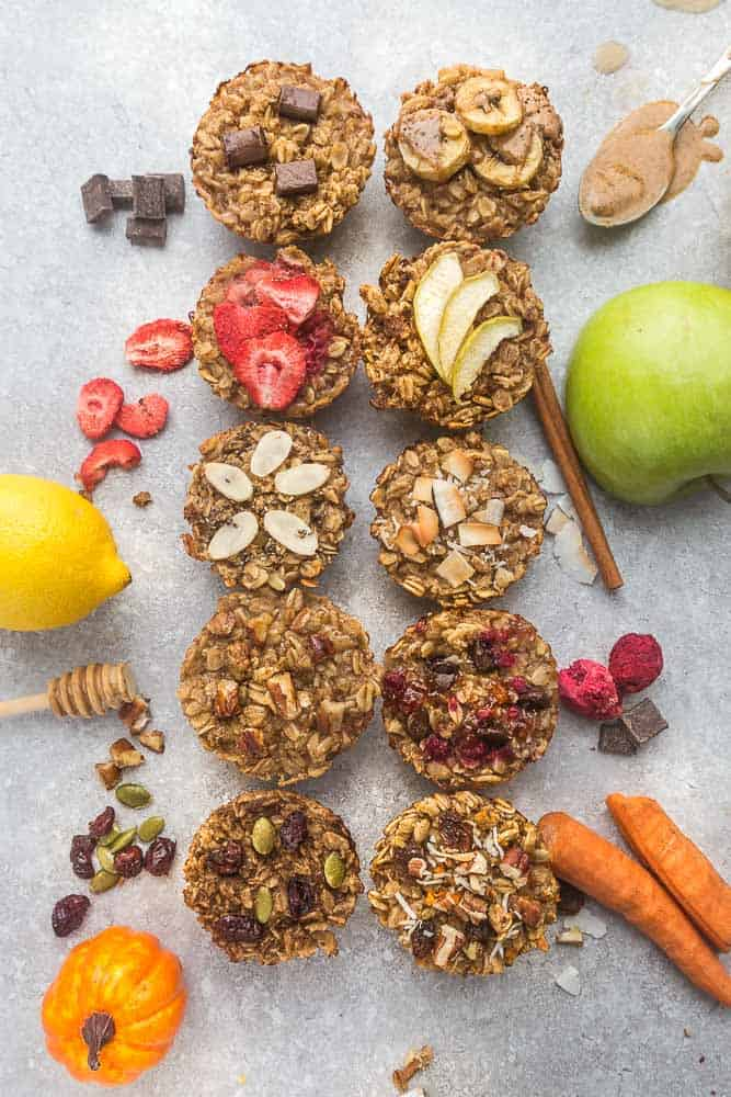 10 healthy instant oatmeal cups surrounded by lemon, pumpkin apples and carrots.