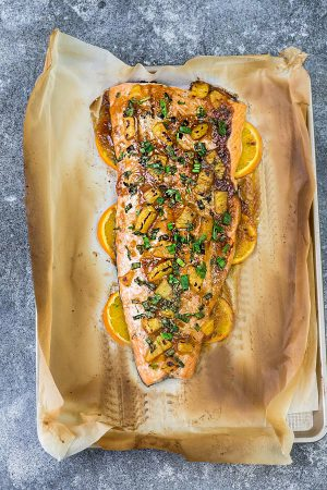 Pineapple Orange Teriyaki Salmon baked in foil or parchment – the perfect easy weeknight dish. Best of all, this healthy recipe takes just 20 minutes to make in just ONE sheet pan so you can totally skip the takeout!