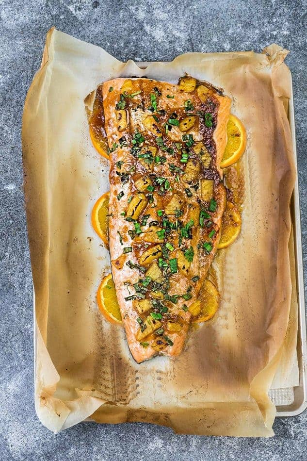 Pineapple Orange Teriyaki Salmon baked in foil or parchment – the perfect easy weeknight dish. Best of all, this healthy recipe takes just 20 minutes to make so you can totally skip the takeout!