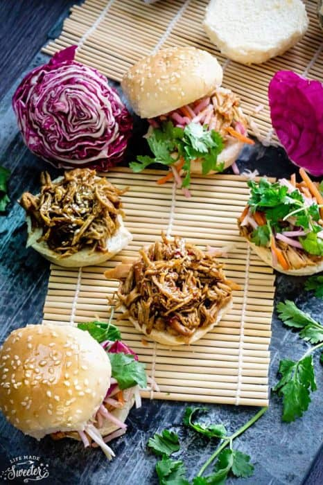 Balsamic Honey Pulled Pork Sliders make the perfect easy dinner or game day party appetizers! Best of all, the soft and tender pork comes together easily in the slow cooker or the oven so you can still watch the football game while these cook up!