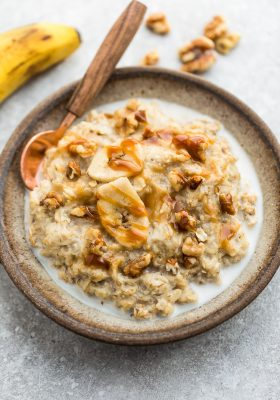 Top view of a bowl of banana oatmeal with a spoon