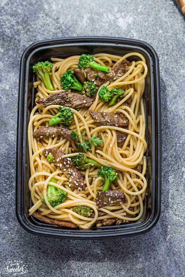 Top view of a leftover container of Beef Lo Mein Noodles with Broccoli