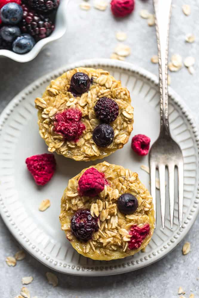 two berry baked oatmeal muffins on a plate