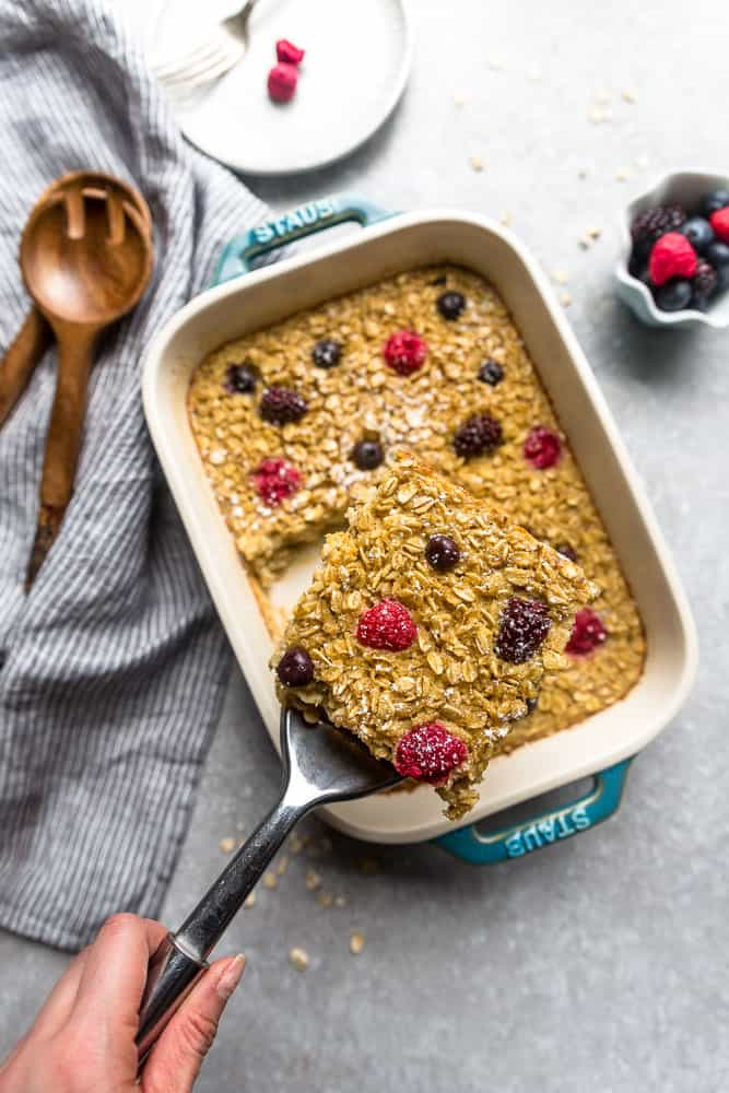 Berry Baked Oatmeal being served from a baking dish