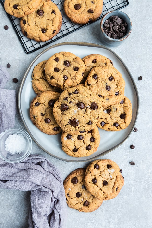 overhead view of Vegan Chocolate Chip Cookies with sea salt on a gray plate