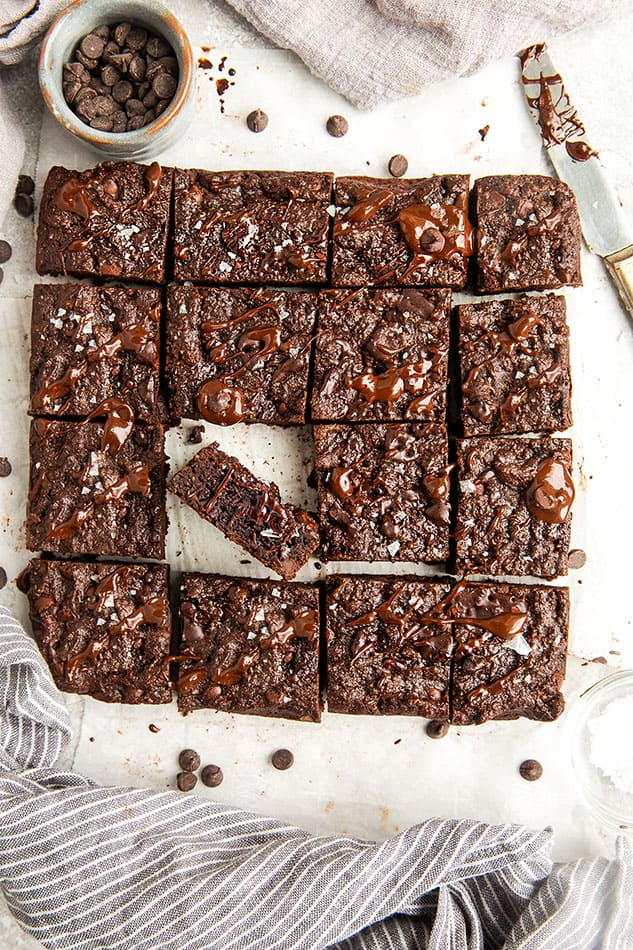 Top view of gluten free paleo brownies on a white backgroumd