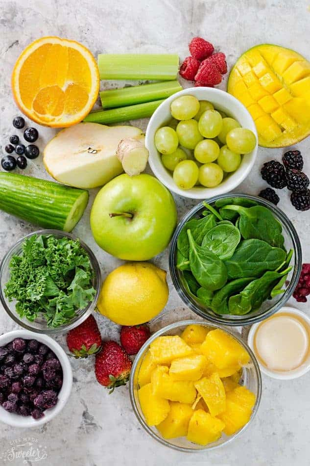 Top view of ingredients to make a green smoothie on a grey background