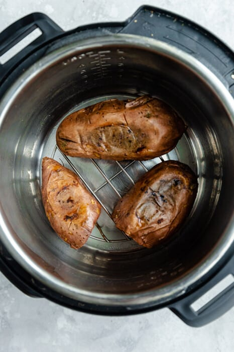 Top view of three baked sweet potatoes in an Instant Pot