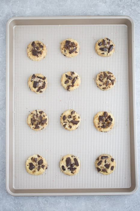 Top view of 12 unbaked Sugar Free Chocolate Chip Cookies on a baking sheet