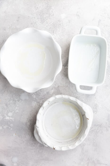 Three White Baking Dishes on a Gray Marble Countertop