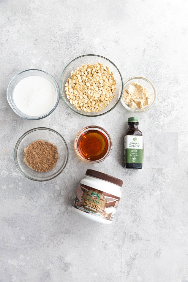 Baking Powder, Maple Syrup, Cinnamon and the Other Baked Oatmeal Ingredients Arranged on a Countertop