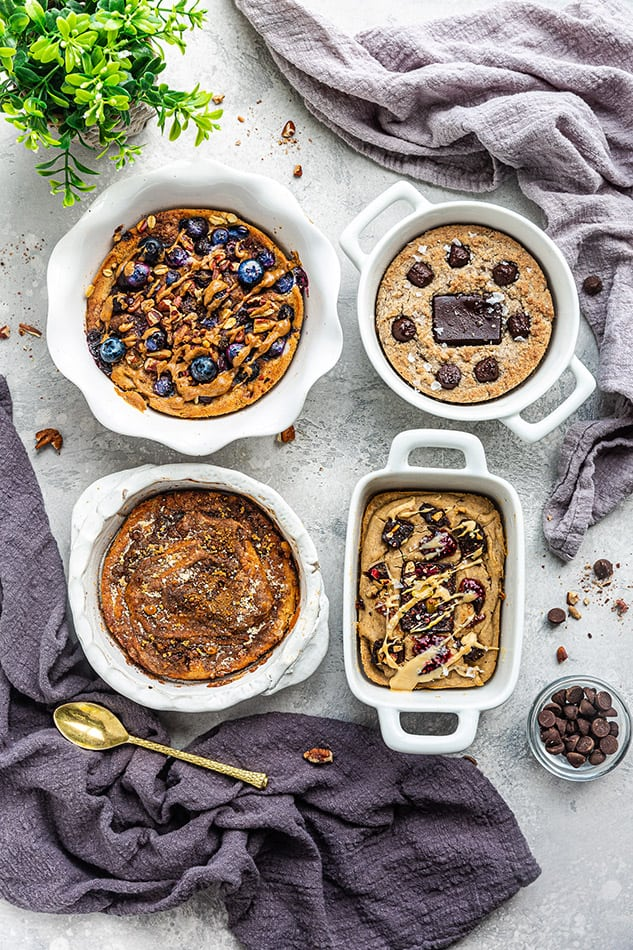 Blueberry Muffin Oatmeal, Churro Oatmeal, PB&J Oatmeal and Grain-Free Oatmeal on a Table with Two Cloths