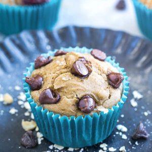 Close-up of a chocolate chip muffin in a blue paper muffin cup